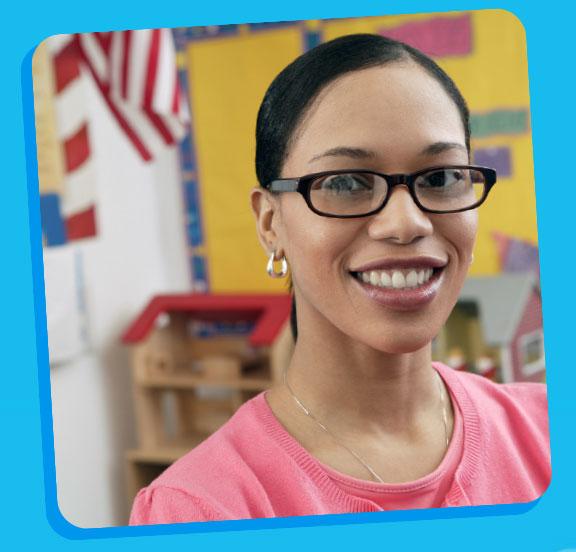 Image of teacher smiling.