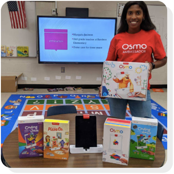 Student standing next to a collection of Osmo products.